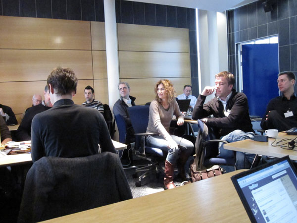photo (61KB) : A University of Bolton meeting room full of standards enthusiasts. Photo courtesy of Tore Hoel