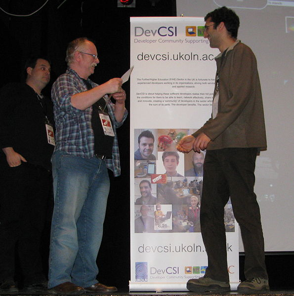 Figure 1: Roger Greenhalgh (left) receiving the Picture This! prize at Dev8D